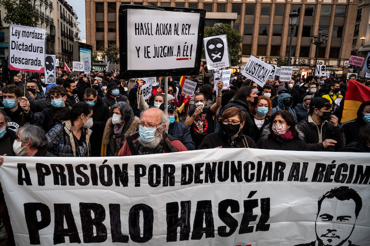 Protesters with placards during a demonstration to protest