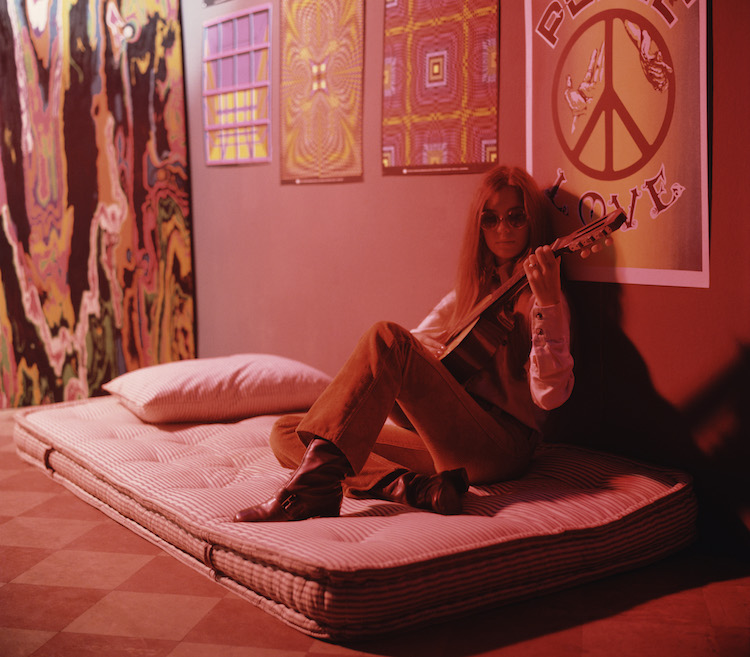 Woman Playing Guitar in Psychedelic Room